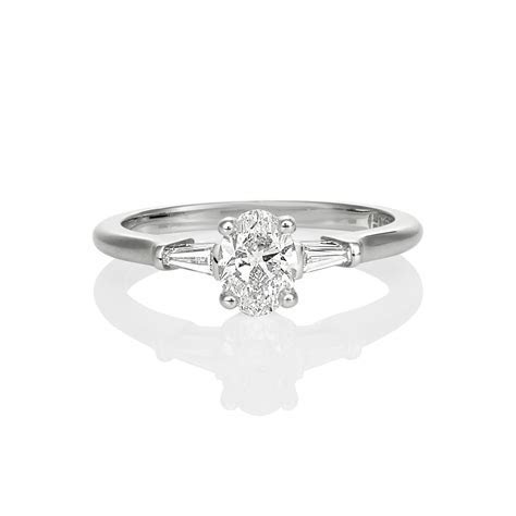 OVAL AND TAPERED BAGUETTE ENGAGEMENT RING ? Nicholas