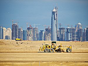 English: Towers rise from the sand at the peak...