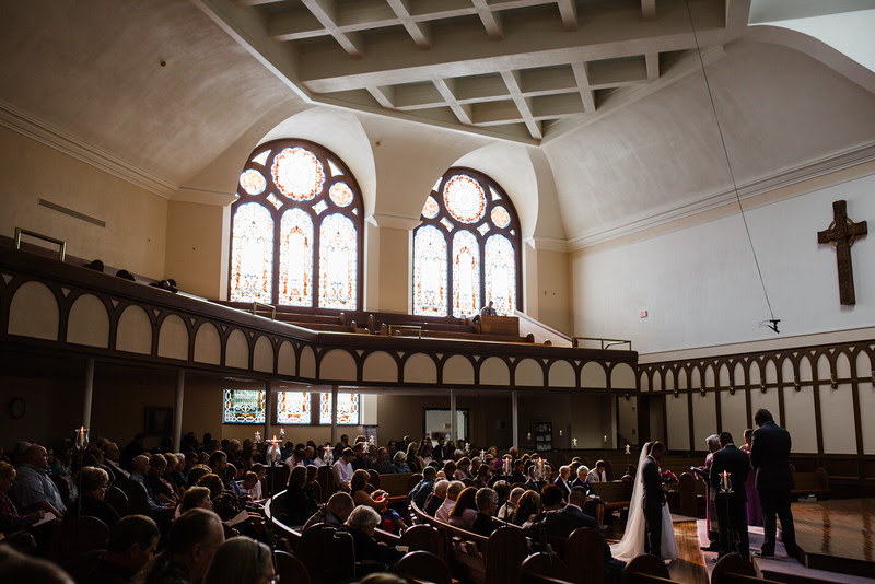 A wedding ceremony at Second First Congregational in downtown Rockord with beautiful indoor ceremony sanctuary with a reception following at the Hoffman House