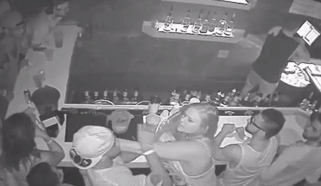 First hit: The woman then takes the first punch, but it's unclear if the blow lands on Johnson