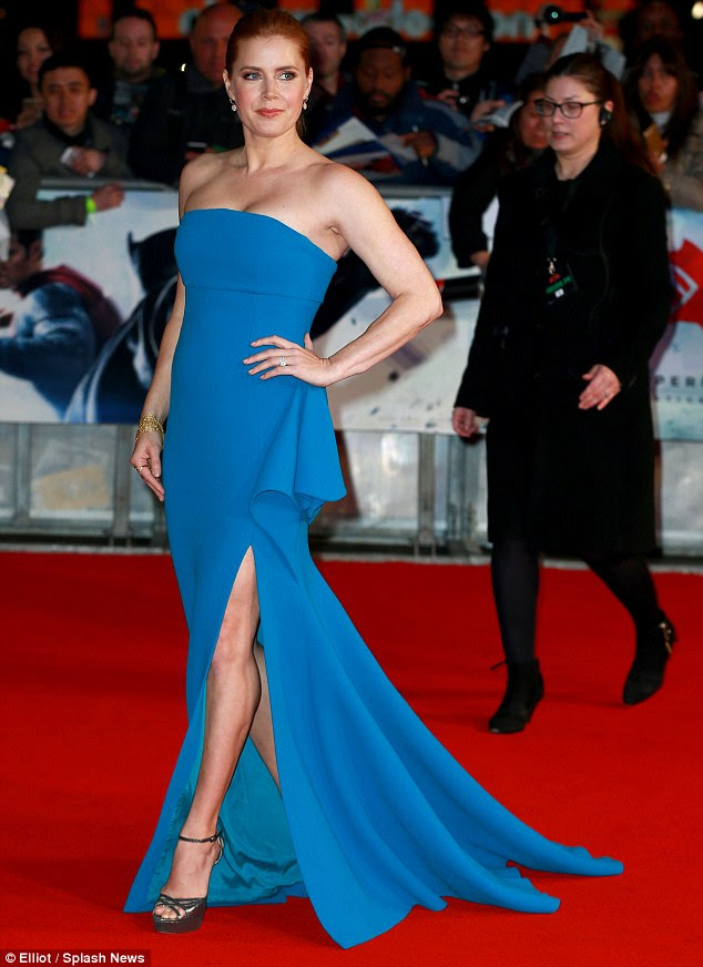 Beautiful in blue: Amy Adams - who plays Lois Lane in the super-hero movie - put on an equally stunning display in a blue thigh-slash dress