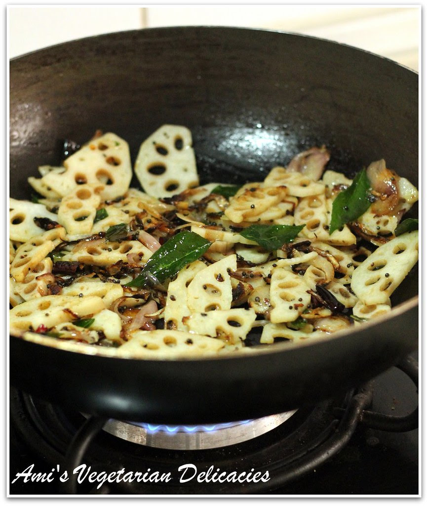 Stir frying lotus root in a large non-stick wok