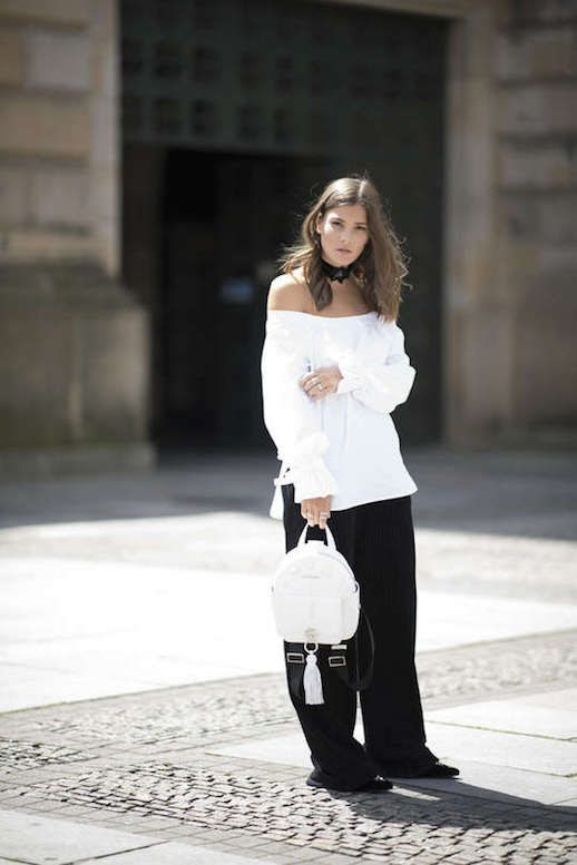 Le Fashion Blog Oversized Trend Off The Shoulder White Blouse Loose Black Trousers Flat Shoes White Backpack Via Vogue Germany