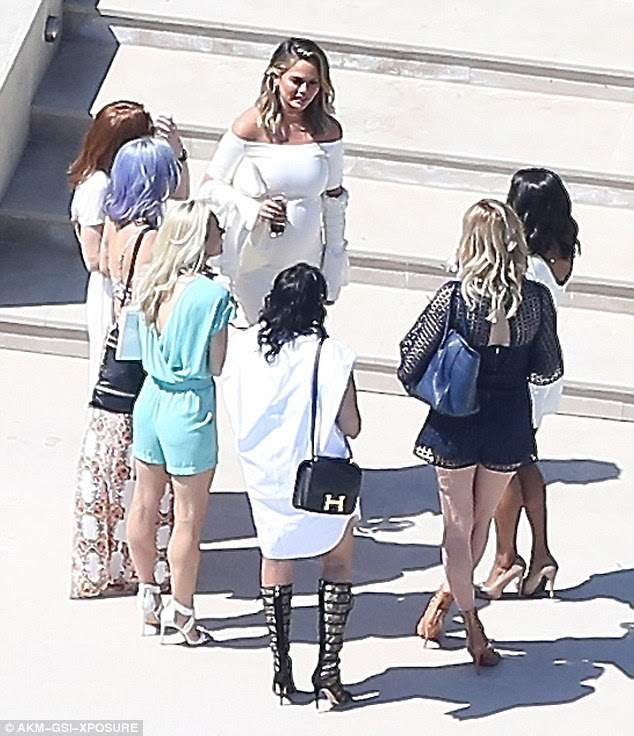 Well-heeled: Chrissy was seen speaking to her various guests, who were all dressed to impress for the affair