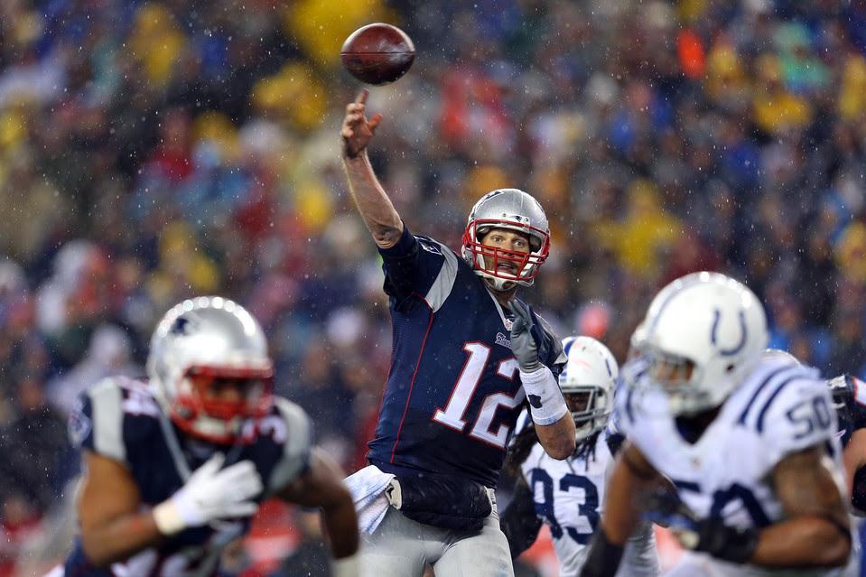 Tom Brady throws a touchdown pass in the third quarter.
