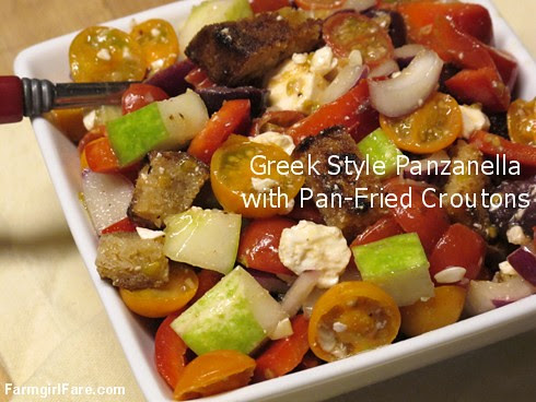 Greek Style Panzanella Salad with cherry tomatoes, kalamata olives, feta cheese, and homemade pan-fried croutons - FarmgirlFare.com