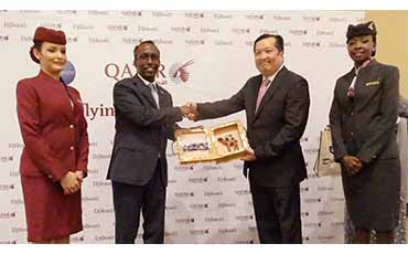 Djibouti's Minister of Transport and Equipment, His Excellency Moussa Ahmad Hassan, second from left, presents Qatar Airways Vice President Africa Jared Lee with a gift during a corporate lunch commemorating the launch of the airline's direct flights to Djibouti in Africa.