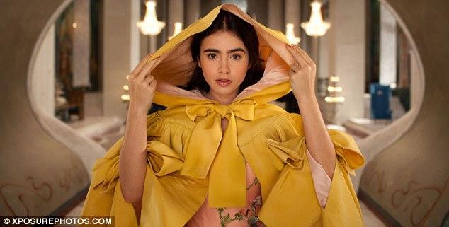 Perigo amarelo: Collins ostenta um manto de mostarda sobre seu manto bordado de mostarda
