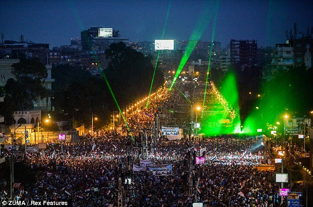 Ecstatic: Opponents of Mohamed Morsi celebrate near the presidential palace after he was ousted from power by Egypt's military