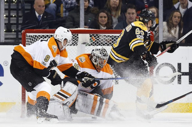 Boston Bruins' Brad Marchand (63) scores on Philadelphia... (AP)