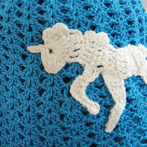 crocheted unicorn on a kids cap