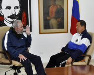 In this photo released by Cubadebate and taken by Estudios Revolucion, Cuba's Fidel Castro, left, speaks to Venezuela's President Hugo Chavez at a hospital in Havana, Cuba, Friday March 2, 2012. Chavez said Friday he's recovering quickly from tumor surgery in Cuba. (AP Photo/Estudios Revolucion)