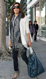 Eva Longoria wearing PRVCY Jeans and Gerard Deral Handbag
