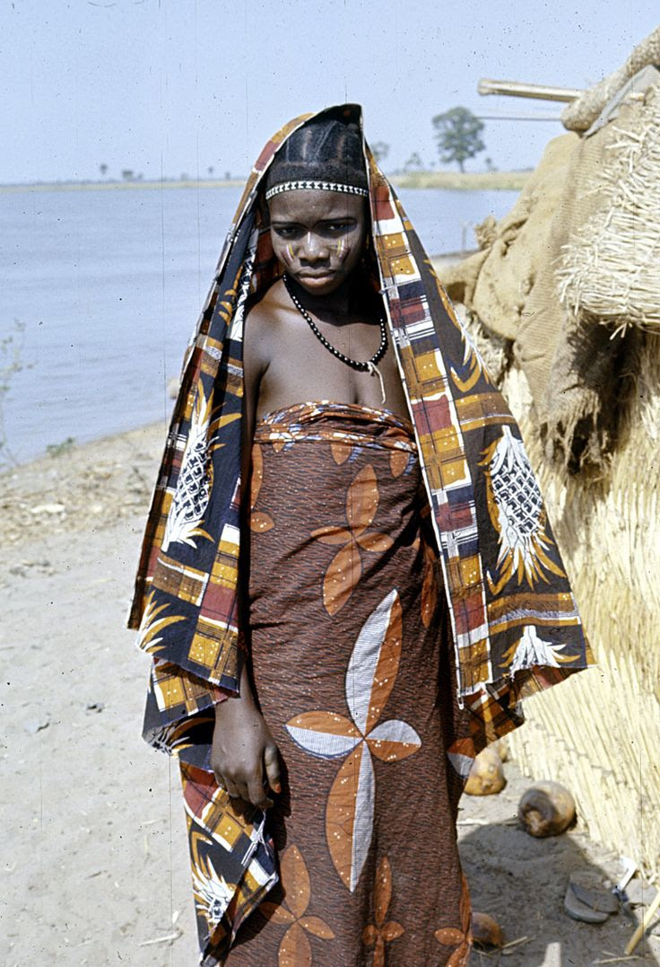 Africa | Dendi girl with facial paint and facial scarification, near Gaya village, Niger | ©Eliot Elisofon.  1970/1