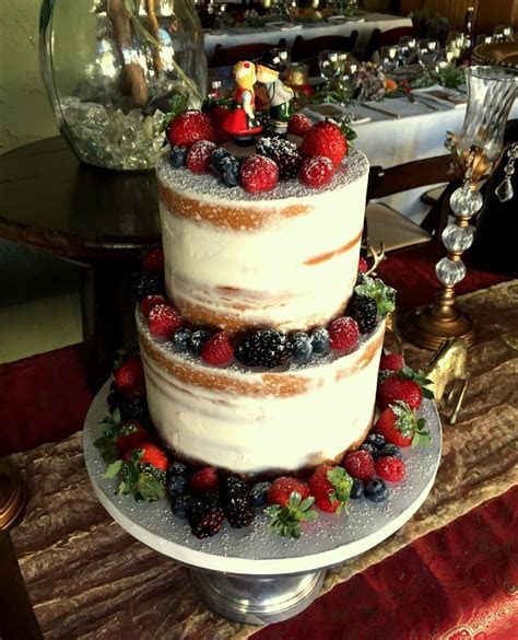 Almost naked cake decorated with fruit and powdered sugar