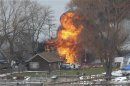 A house burns after a man set fire and then shot and killed a responding police officer and a firefighter while injuring two other firefighters in Webster New York