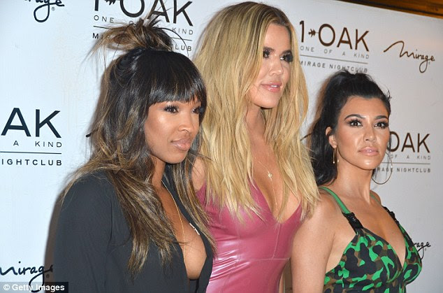 Now that's buxom! Khloe looked to be lapping up the attention
