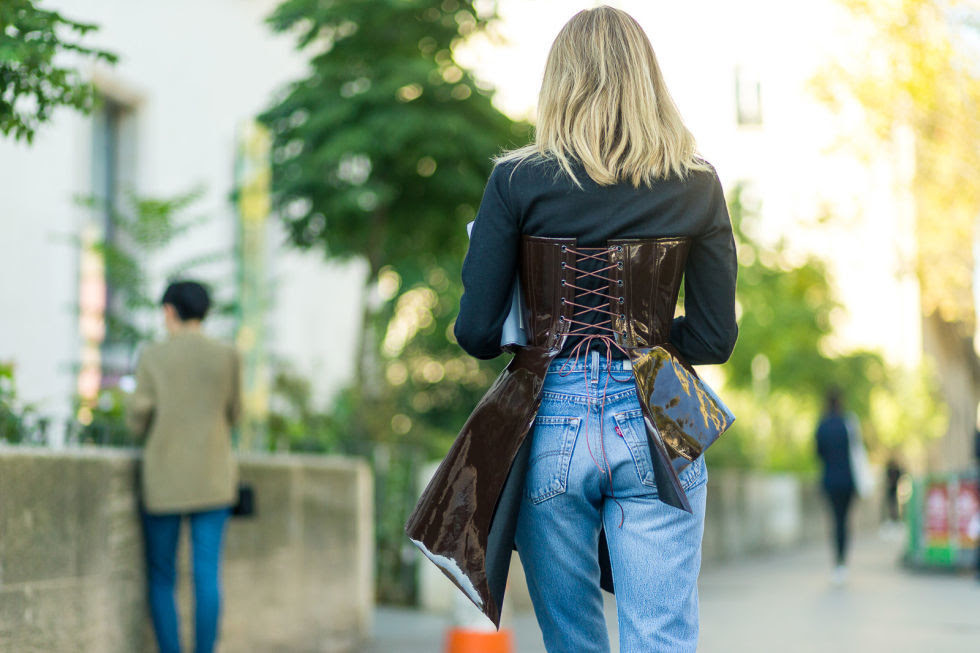 Dress down a statement-making corset with a pair of jeans and a t-shirt for the perfect contrast.