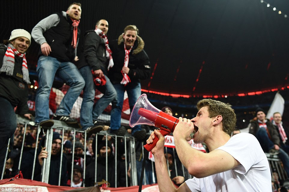 Bayern  hero Muller celebrates with supporters and shouts into a megaphone after the German side secured their place in the last eight