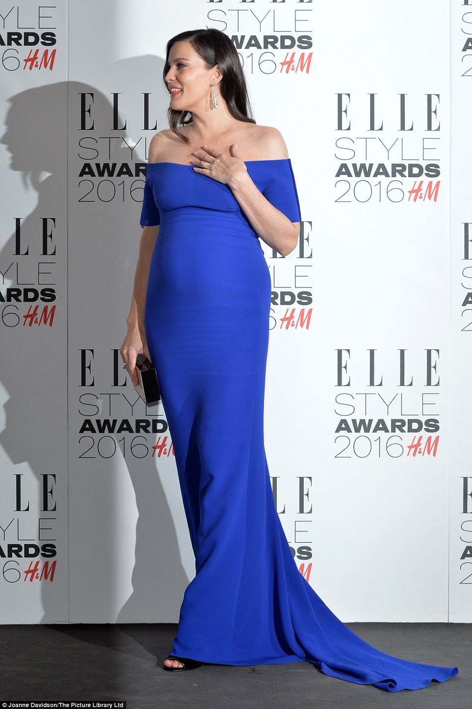 Exquisite: Heavily pregnant Liv Tyler was bold and beautiful in bright blue to break up the black and white palette on the night