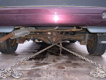 The chains securing a Mazda MPV minivan being ...