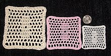 A demonstration of crochet thread weight: sample filet crochet pattern repeated in different threads.  From left to right: size 3, size 10, and size 20.  A U.S. quarter is included for perspective.