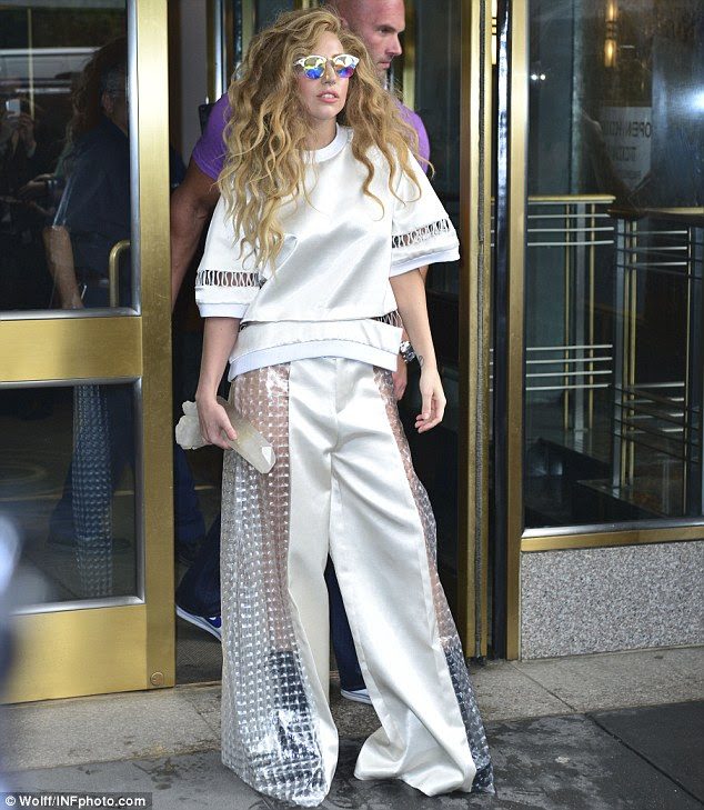 Rainbow bright: Gaga has taken to wearing reflective pixelated glasses that make her look even more bizarre
