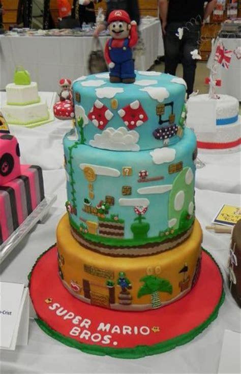 3 tier Super Mario cake with Super Mario on top (1