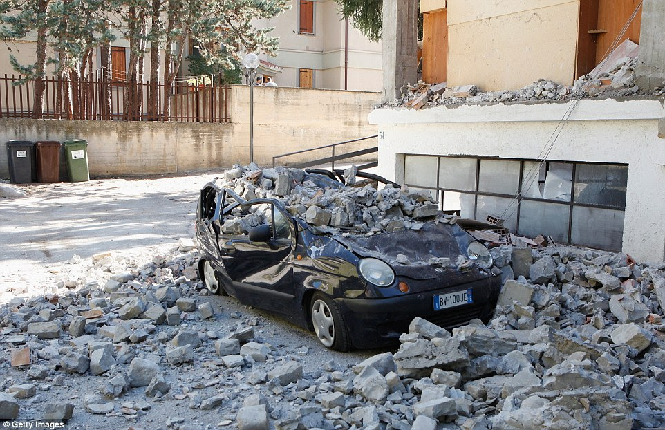 This car in Amatrice was completely crushed by falling rubble but thankfully no passengers were inside it at the time