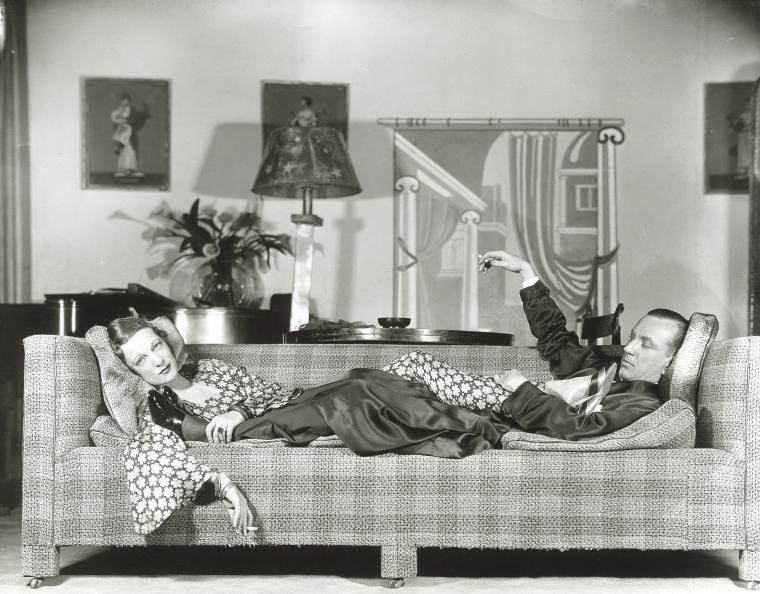 """Gertrude Lawrence and Noel Coward on sofa in """"Private Lives."""""""