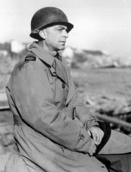In this March 1, 1944 file photo, Ed Kennedy, Chief of the Associated Press staff in North Africa, wears a metal helmet at the Anzio beachhead in Italy. Kennedy was dismissed by The AP after he became the first journalist to file a firsthand account of German officials surrendering unconditionally to Allied commanders at a former schoolhouse in Reims, France. Sixty-seven years later, AP President and Chief Executive Officer Tom Curley said that Kennedy was right to stand up to the censors, and should have been commended, not fired. (AP Photo, Pool)