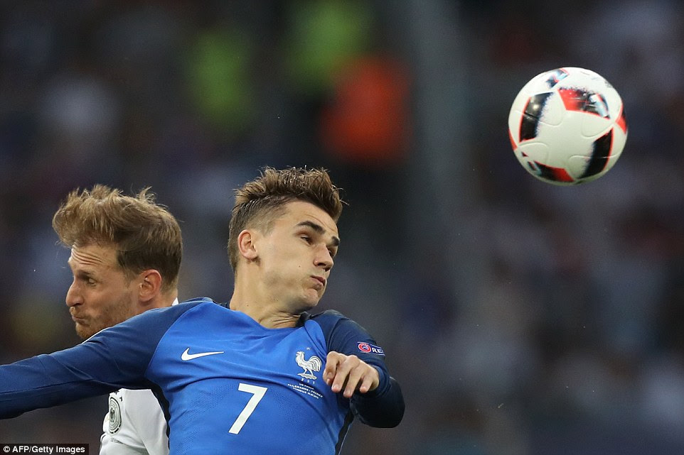Griezmann leaps to head the ball as the host nation made a bright start to proceedings on the south coast of France