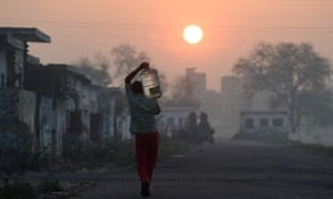 A migrant laborer carries a bottle of water in the Dwarka sector of New Delhi. A UN report released in March warned of an urgent need to manage the world's water more sustainably and said too much groundwater is being extracted in India and China.