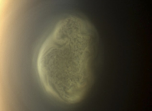 Titan's colorful south polar vortex captured by NASA's Cassini spacecraft before a distant flyby of Saturn's moon Titan on June 27, 2012, shows a south polar vortex, or a mass of swirling gas, around the pole in the atmosphere