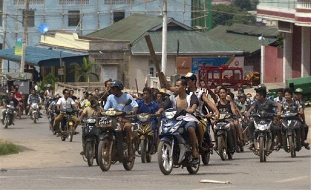 Hundreds of Buddhists on motorcycles armed with sticks patrol in the streets of in Lashio, northern Shan State, Myanmar,