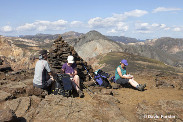 06D-1403 Hikers Taking a Break on Kjaftalder with Mountain of Blahnukur Behind Landmannalaugar Iceland.