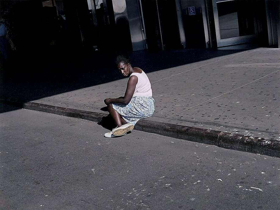 "A woman sits on a sidewalk in New York, which is from the series ""American Night, 2002."" Photo: Paul Graham, Courtesy Pace/MacGill Gallery"