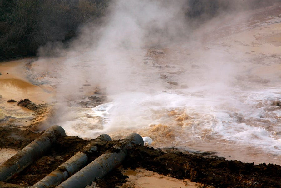 Polluted water from a rare earth smelting plant spews into a tailings dam near Xinguang Village. China supplies 97 percent of rare earths used worldwide, which are used for magnets, bearings and high-tech components that go into computers, vehicles and, increasingly, clean energy technology such as wind turbines and hybrid cars.
