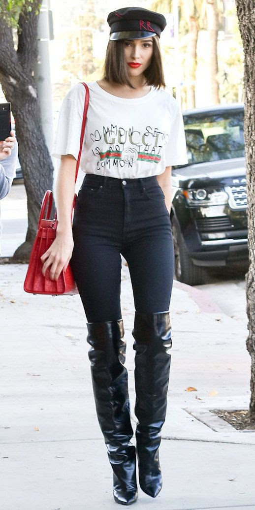 Le fashion Blog Olivia Culpo Edgy Outfit Black Cap Gucci T Shirt Skinny Jeans Red Bag Knee High Leather Boots Via Instyle