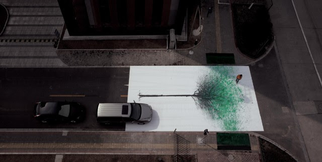 Green Pedestrian Crossing in China Creates Leaves from Footprints trees leaves installation environment China advertising