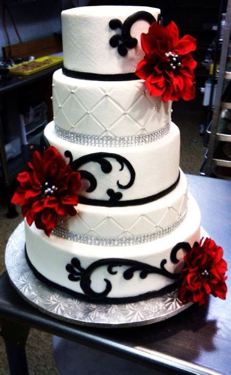 Red, black and white wedding cake with diamond ribbon