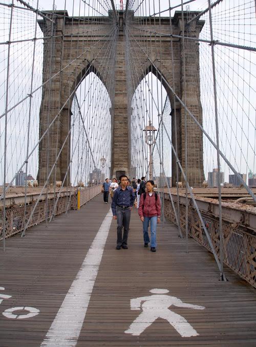 little man on the Brooklyn Bridge, New York City