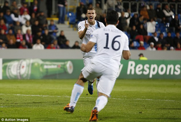Breaking the deadlock: Dzeko celebrates his goal shortly after half time
