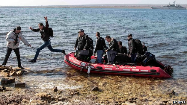 Crew members of a Ukrainian naval vessel come ashore in Donuzlav Bay, Crimea (24 March)