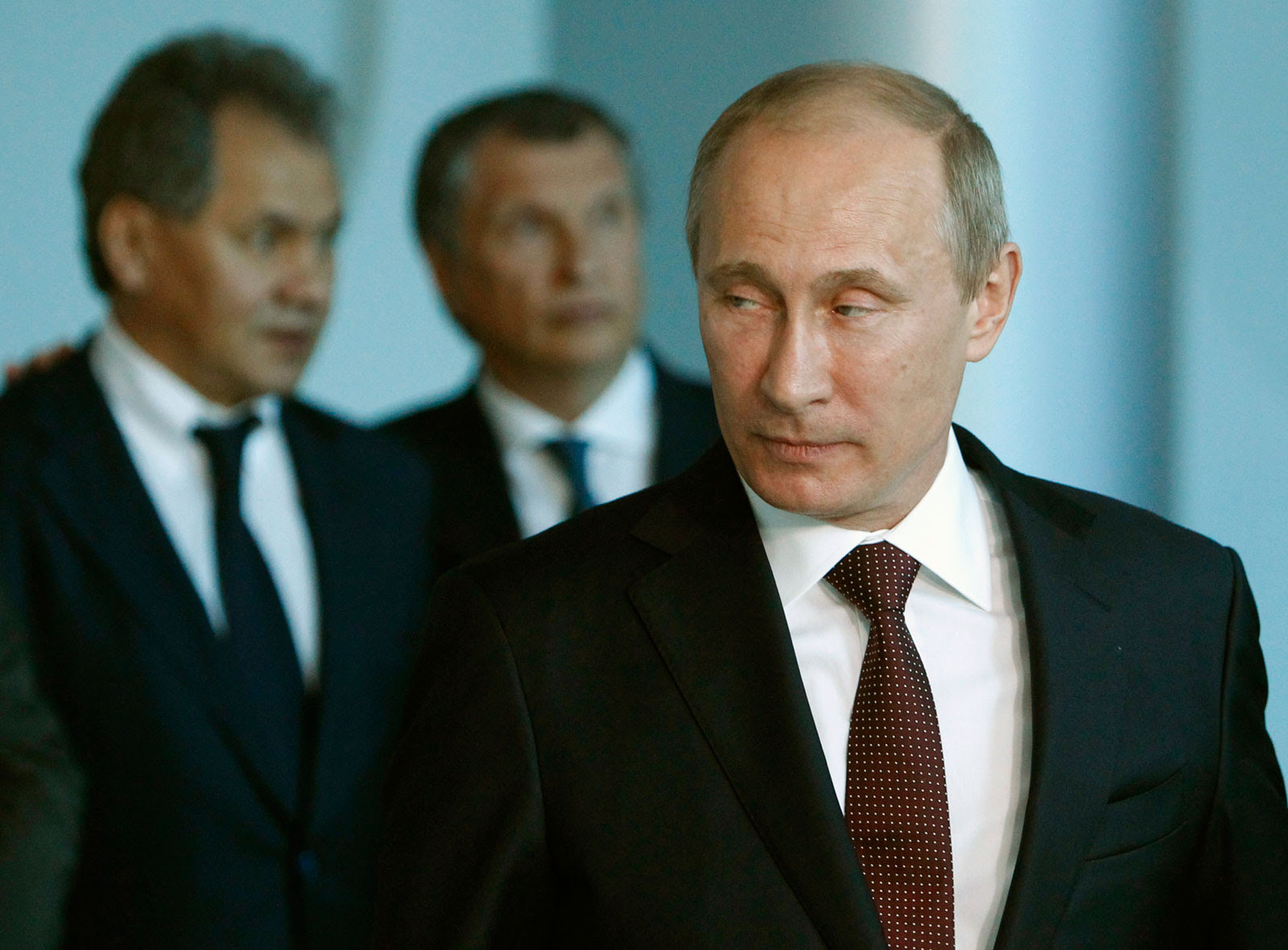 Defense minister Sergei Shoigu and then-deputy prime minister Igor Sechin with Russian President Vladimir Putin at the International Economic Forum, St. Petersburg, Russia, June 21, 2012