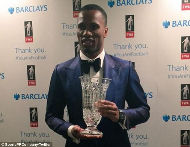 Chelsea striker Didier Drogba poses with his award at the Football Writers' Association Gala Tribute evening