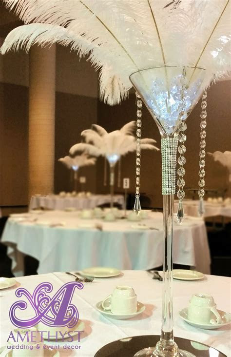 White ostrich feather centerpiece with martini vase