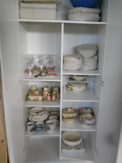 Grandmother's China Dishes in Kitchen Cabinet