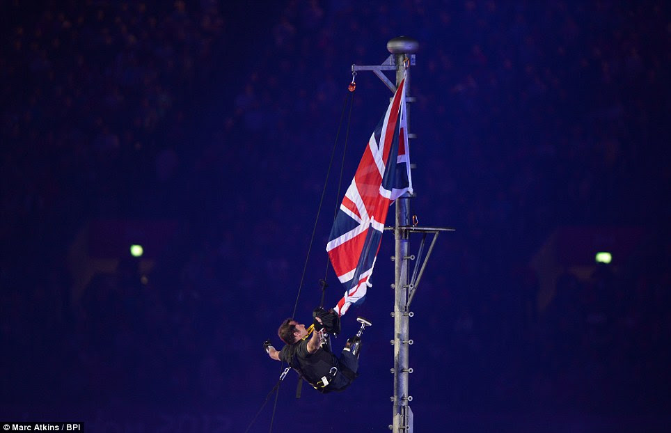 Inspiration: Captain Luke Sinnott, who lost his legs and an arm in Helmand, climbs a flagpole to proudly unfurl the Union Flag as the Paralympic Closing Ceremony gets underway at the Olympic Stadium in London