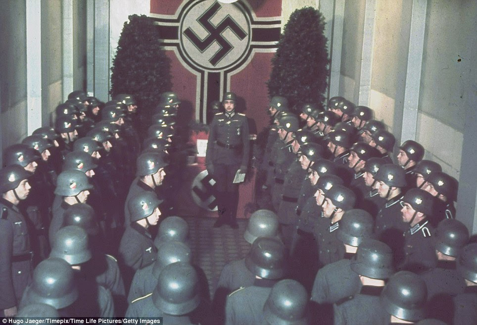 Chilling: Solemn Nazi soldiers gather to celebrate the fascist leader's birthday at the West wall in Germany